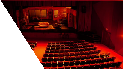 Empty theatre with living room interior set-up on the stage