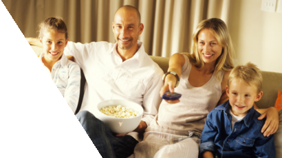 Family watching TV together with a bowl of popcorn