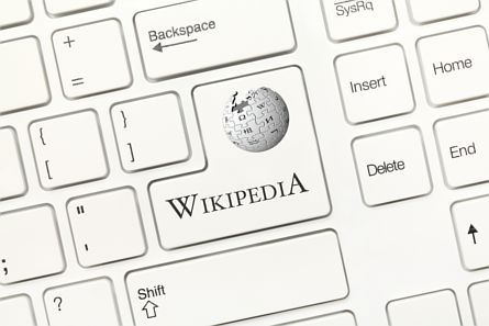 Wikipedia button on a computer keyboard in shape of the Enter key